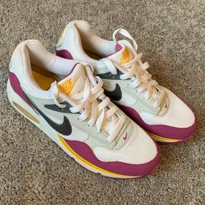 Nike Air Max Sunrise athletic shoes